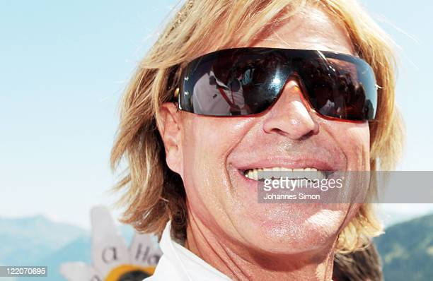 Austrian singer Hansi Hinterseer smiles during his annual fan hiking tour beginning at the peak of the Hahnenkamm mountain on August 25, 2011 in...