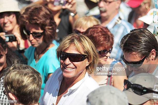 Austrian singer Hansi Hinterseer walks on during his annual fan hiking tour beginning at the peak of the Hahnenkamm mountain on August 25, 2011 in...