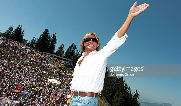 Austrian singer Hansi Hinterseer waves to his fans ahead his annual fan hiking tour beginning at the peak of the Hahnenkamm mountain on August 25,...