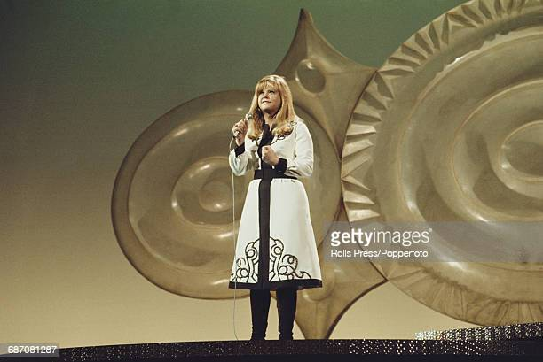 Austrian singer Marianne Mendt performs the song 'Musik' on stage for Austria in the 1971 Eurovision Song Contest at the Gaiety Theatre in Dublin...