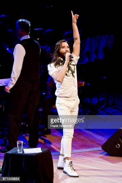 Austrian singer Tom Neuwirth aka Conchita performs live on stage during a concert at the Philharmonie on November 7 2017 in Berlin Germany