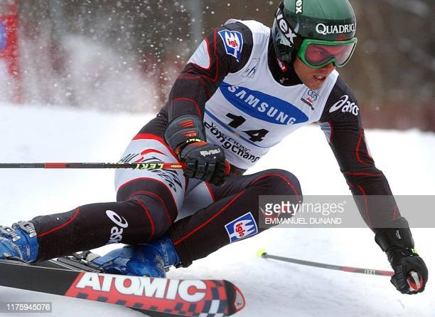 Austrian skier Heinz Schilchegger powers his way down a slope 01 March 2003 to finish fourth in the World Cup Men's Giant Slalom in Yongpyong some...