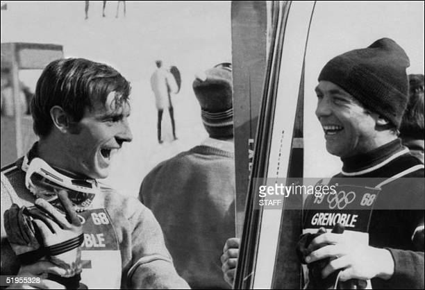 Austrian skier Karl Schranz and Frenchman JeanClaude Killy share a laugh at the end of a skiing practice 14 February 1968 in Chamrousse near Grenoble...