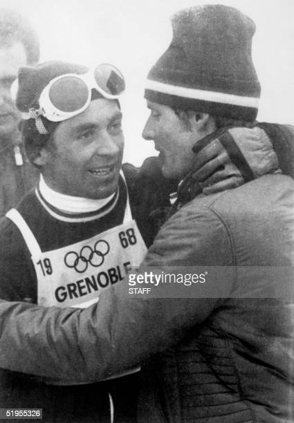 Austrian skier Karl Schranz is congratulated by Frenchman JeanClaude Killy following his victory in the slalom 17 February 1968 in Chamrousse near...