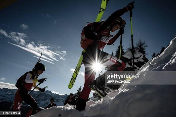 Austrian skier Lisa Rettensteiner and Spanish skier Ares Torra Gendrau compete during the individual women's ski mountaineering 2020 Lausanne Winter...