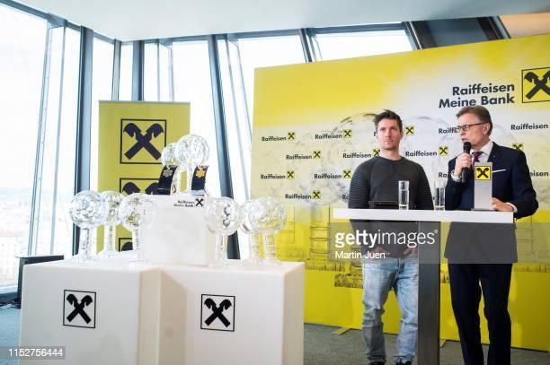 Austrian skier Marcel Hirscher and Head of Group Marketing of Raiffeisen International Leodegar Pruschak at the press conference at Raiffeisen Bank...