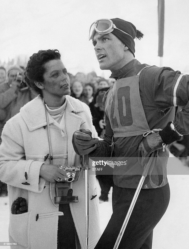 Austrian skier Toni Sailer is surrounded by fans in February 1956 in Cortina d'Ampezzo during the Winter Olympic Games. Sailer won three gold medals (downhill, slalom and giant slalom) during the competition.