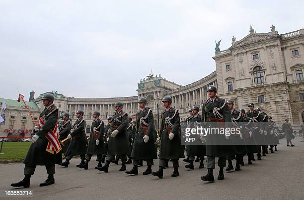 Austrian soldiers walk past the Neue Burg as they attend a ceremony to mark the 75th anniversary of the Anschluss of Austria to the Third Reich in...
