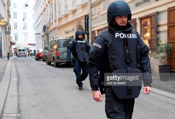 Austrian special force officers control the site of a shooting outside Figlmueller passage in the city center of Vienna Austria on December 21 2018...