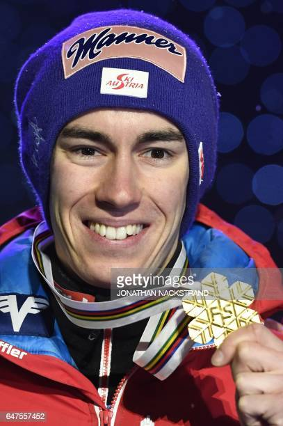 Austrian Stefan Kraft celebrates during the medals ceremony for the men large hill individual ski jumping competition of the FIS Nordic Ski World...