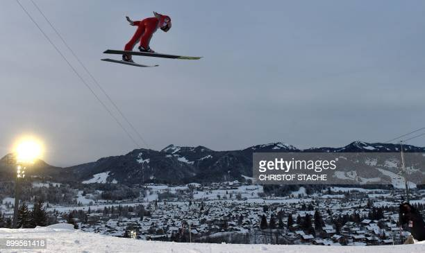 Austrian Stefan Kraft soars through the air during his training jump ahead of the ski jumping event in Oberstdorf southen Germany which is the first...