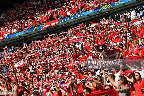 Austrian supporters cheer before the Euro 2016 group F football match between Iceland and Austria at the Stade de France stadium in SaintDenis near...