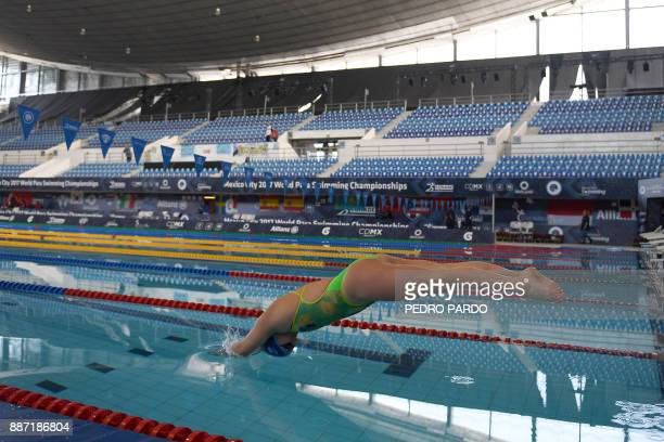 Austrian swimmer Sabina Weber warms up during the Mexico City 2017 World Para Swimming Championship in Mexico City on December 6 2017 / AFP PHOTO /...