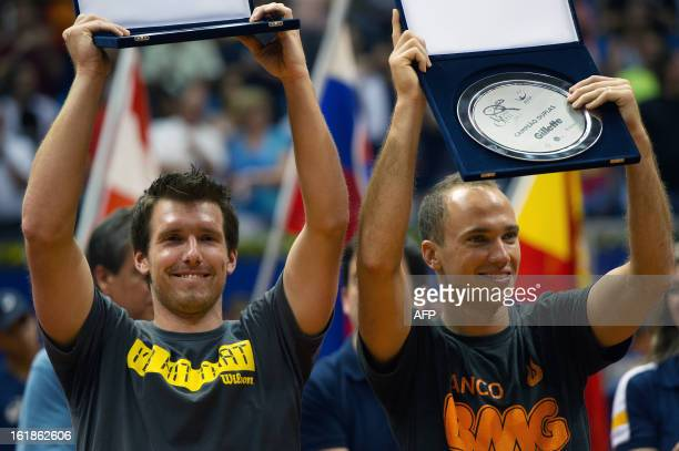 Austrian tennis player Alexander Peya and Brazilian Bruno Soares celebrate their victory on doubles in the Brazil Open, during the award ceremony at...