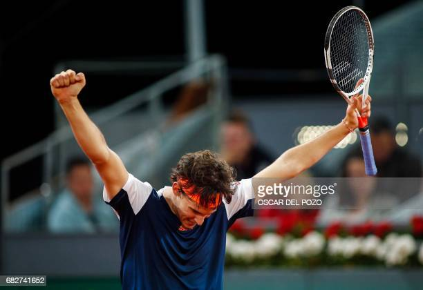 Austrian tennis player Dominic Thiem celebrates his victory over Uruguayan tennis player Pablo Cuevas during the ATP Madrid Open semifinal in Madrid,...