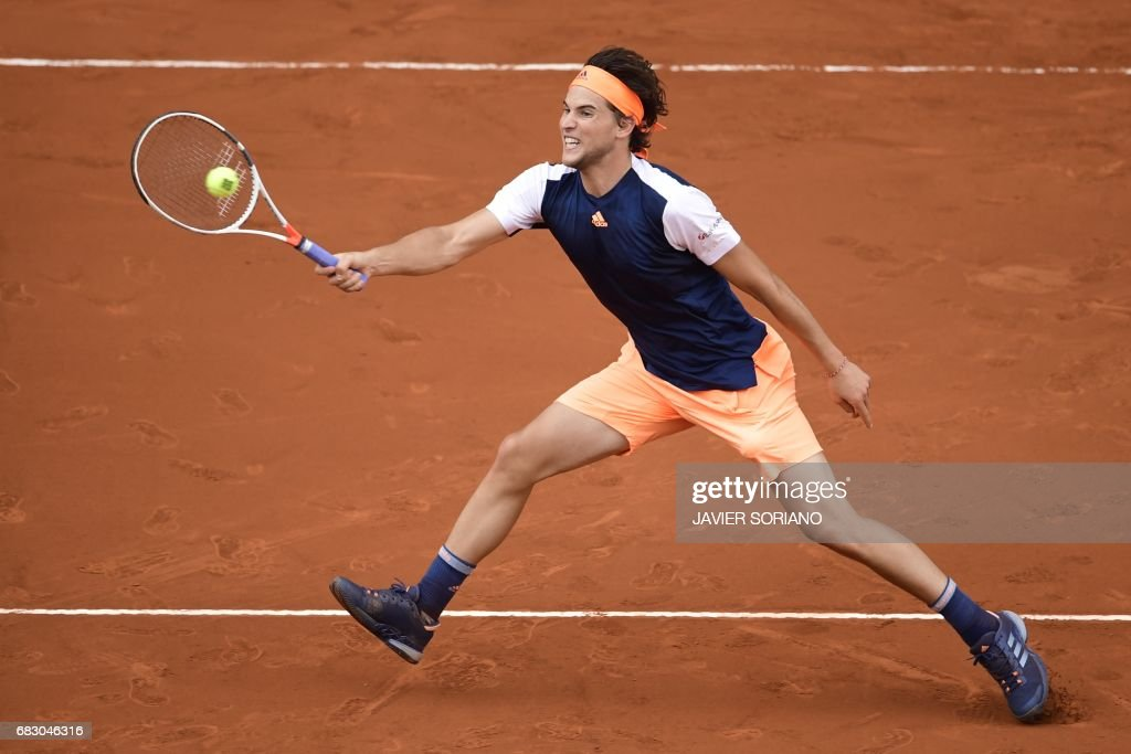 Austrian tennis player Dominic Thiem returns the ball to Spanish tennis player Rafael Nadal during their ATP Madrid Open final match in Madrid, on May 14, 2017. Nadal won 7-6 and 6-4. /