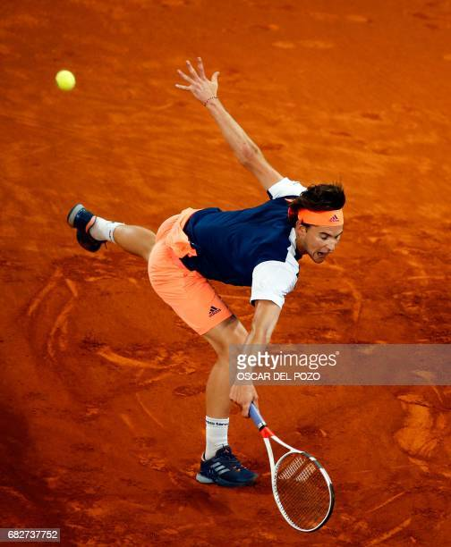 Austrian tennis player Dominic Thiem returns the ball to Uruguayan tennis player Pablo Cuevas during the ATP Madrid Open semifinal in Madrid, on May...