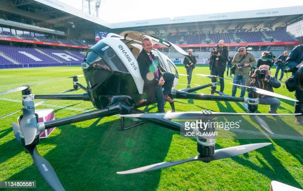 Austrian transport minister Norbert Hofer sits at an Air Taxi EHANG 216 during a press preview of FACC AG on Urban Air Mobility at Generali Arena in...