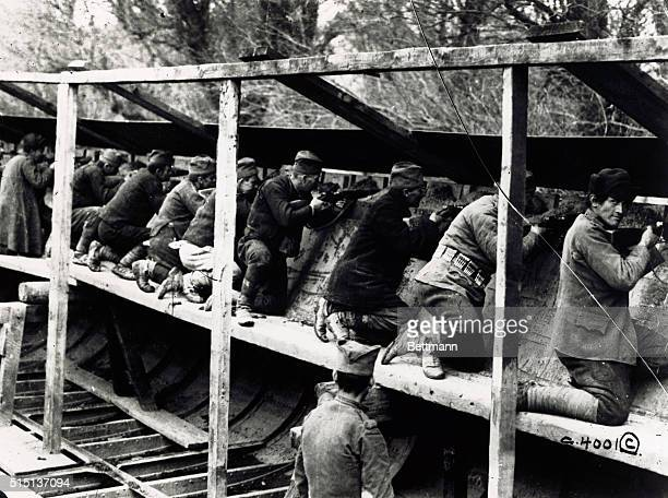Austrian Trenches Raked By Serbian Infantrymen Entrenched In Steel Barges Mounted on platforms within the barges the Serbian marksmen pour a deadly...