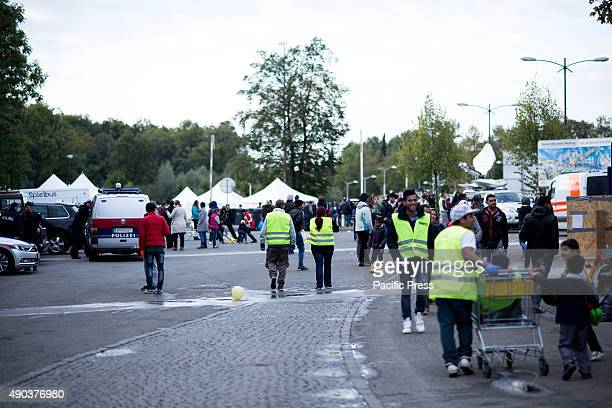 FREILASSING BAVARIA GERMANY Austrian volunteers support refugees awaiting to cross over with clothing food and tents Thousands of migrants escape...