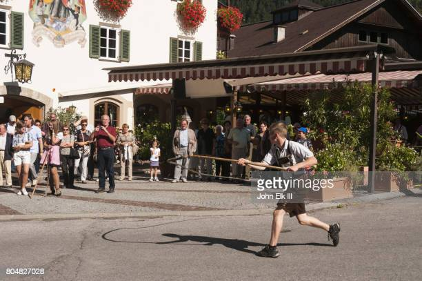 austrian whip cracking competition - peitsche stock-fotos und bilder