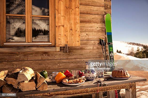 Austrian winter picnic in front of a wooden chalet
