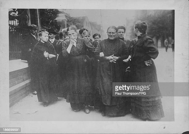Austrian women waiting for the current death lists to be posted from the front lines during World War One Austria circa 19141918