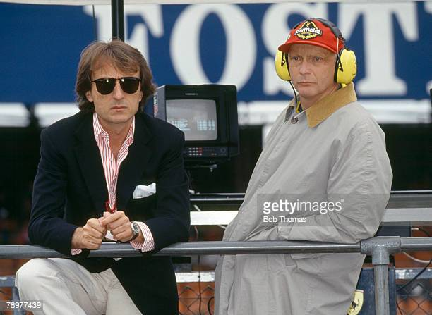 Austrian world champion racing driver Niki Lauda pictured on right with Chairman of Ferrari Luca Cordero di Montezemolo as they attend the 1992...
