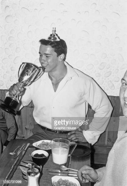 Austrian-American bodybuilder and actor Arnold Schwarzenegger with his Mr Universe trophy after winning the contest in London, UK, September 1967.