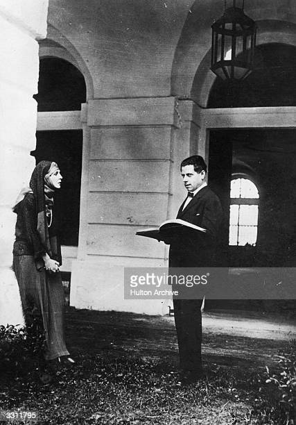 AustrianAmerican theatre director Max Reinhardt rehearses with British socialite Lady Diana Cooper in costume for her performance in Reinhardt's...