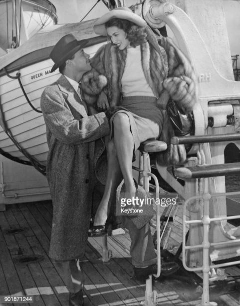 Austrianborn actor Turhan Bey sees actress Linda Christian off on the 'SS Queen Mary' at New York bound for England 28th September 1947