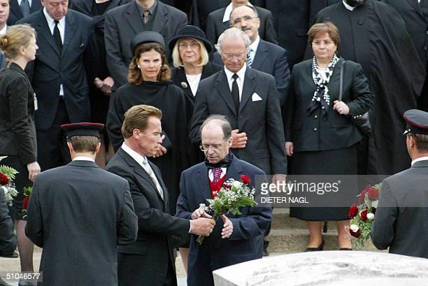 Austrianborn actor turned politician Arnold Schwarzenegger gives a posy to Kosovo's ethinc Albanian President Ibrahim Rugova as Swedish Queen Silvia...