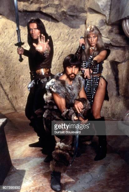 Austrianborn American actor Arnold Schwarzenegger American actors Gerry Lopez and Sandahl Bergman on the set of Conan the Barbarian directed by John...