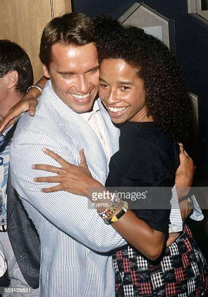 Austrianborn American actor Arnold Schwarzenegger hugging actress Rae Dawn Chong his costar in the movie 'Commando' circa 1985
