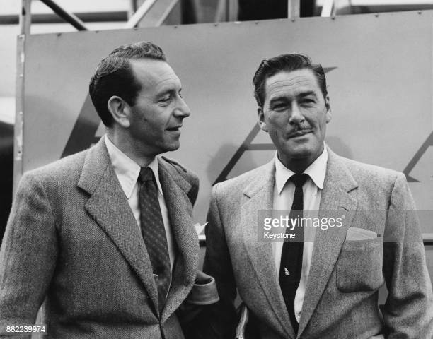 Austrianborn American actor Paul Henreid and Australianborn American actor Errol Flynn arrive in London Airport to begin work on their next films...