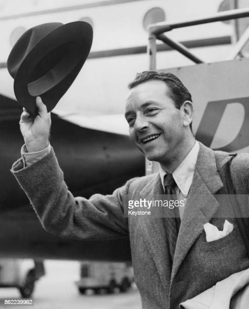 Austrianborn American actor Paul Henreid arrives in London Airport to begin work on his next film 12th June 1952