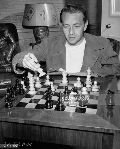 Austrianborn American actor Paul Henreid playing chess circa 1945