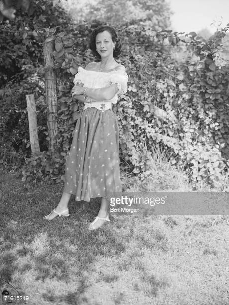 Austrian-born American actress and communications technology innovator Hedy Lamarr wears a gypsy sort of outfit during a trip to a children's costume...