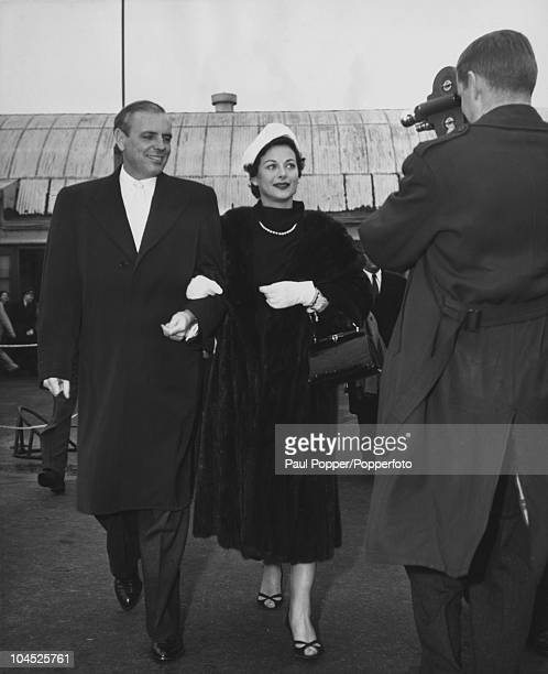 Austrianborn American actress Hedy Lamarr with her fifth husband W Howard Lee on their way to spend Christmas in Los Angeles December 1953