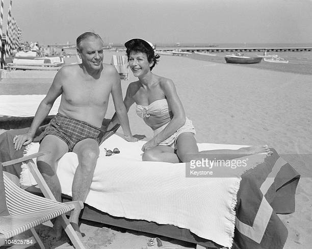 Austrian-born American actress Hedy Lamarr with her fifth husband, W. Howard Lee, at the lido during the Venice Film Festival, 5th September 1955.