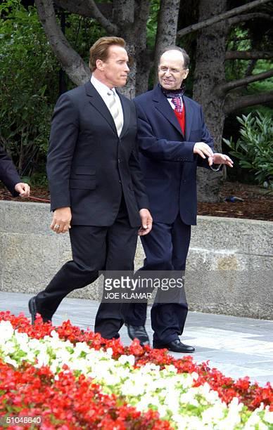 Austrianborn California Gov Arnold Schwartzenegger and Kosovo President Ibrahim Rugova leave the graveside of Austrian President Thomas Klestil after...