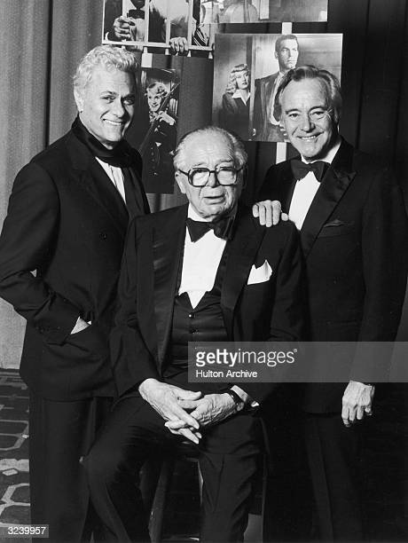 Austrianborn director Billy Wilder sitting on a stool flanked by American actors Tony Curtis and Jack Lemmon who starred in Wilder's 1959 film 'Some...