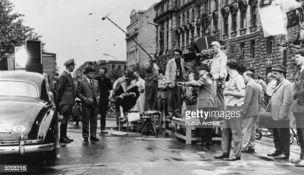 Austrianborn filmmaker Billy Wilder directs a scene with American actor James Cagney on the set of Wilder's film 'One Two Three' West Berlin West...