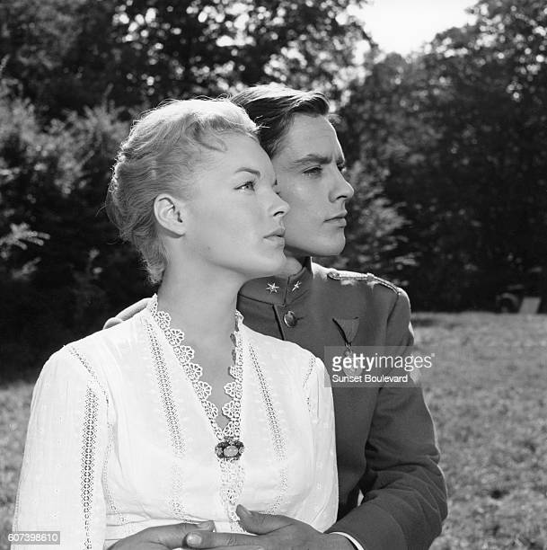 Austrianborn German actress Romy Schneider and French actor Alain Delon on the set of Christine written and directed by Pierre GaspardHuit