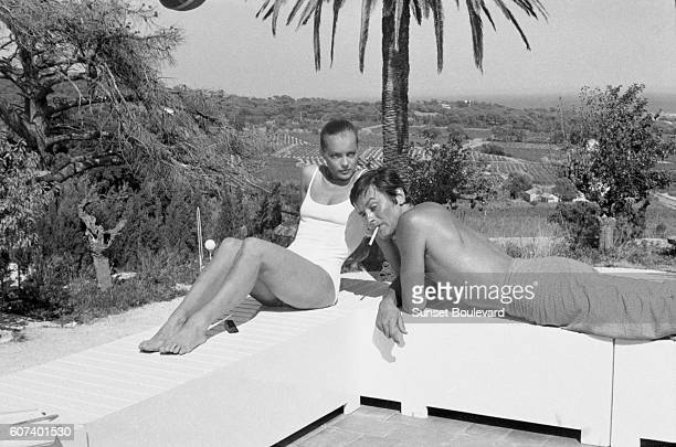 Austrian-born German actress Romy Schneider and French actor Alain Delon on the set of La Piscine directed by Jacques Deray.