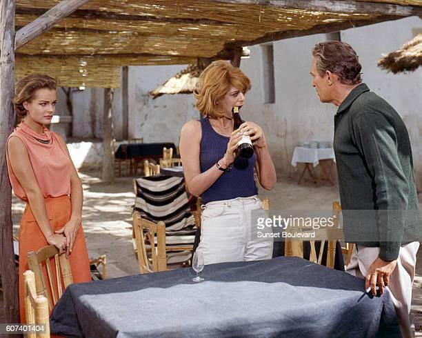 Austrianborn German actress Romy Schneider Greek actress Melina Mercouri and Britishborn Australian actor Peter Finch on the set of 1030 PM Summer...