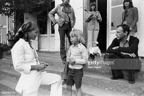 Austrianborn German actress Romy Schneider with her son David and French actor JeanLouis Trintignant on the set of Le Train based on the novel by...