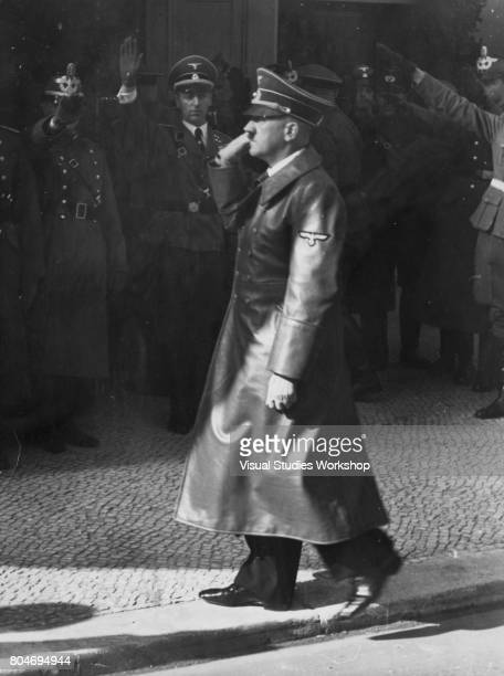 Austrianborn German dictator Adolf Hitler salutes uniformed officers on his way to deliver a speech Berlin Germany October 6 1939