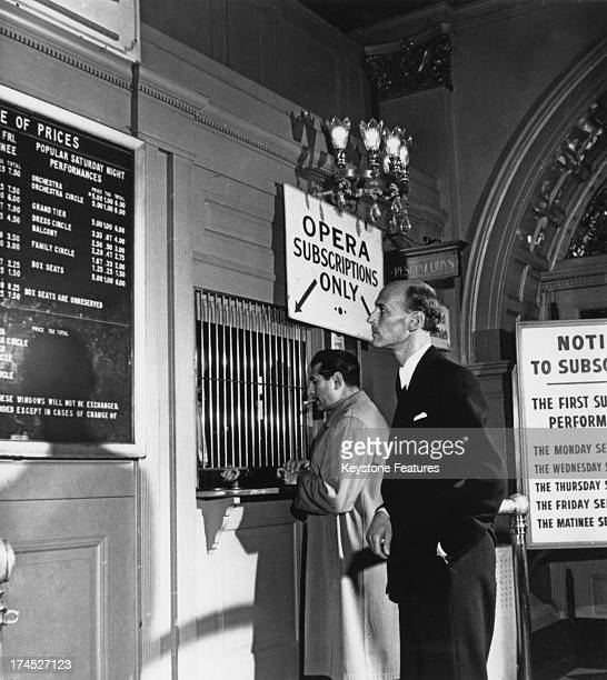 Austrianborn opera impresario Rudolf Bing checks the prices of the seats in the foyer of the New York Metropolitan Opera where he is now the manager...