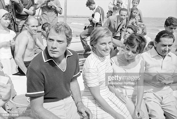 Austrianborn Swiss actress Maria Schell French actress Pascale Petit and French director and actor Christian Marquand surrounded by curious and...